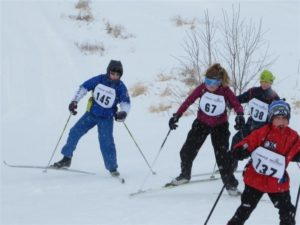 Nellie Stone skier Kristopher Cubias gaining speed in a race.