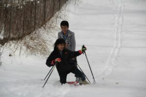Awatin Skiers laugh as they climb the hill and set the first tracks in Eloise.