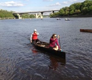 Loppet Foundation and MCA members paddle during a Rookies session on the Mississippi River.