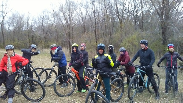Edison Outdoor Club members taking a break from mountain biking.