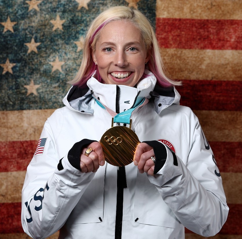 Kikkan Randall with Olympic Gold Medal.